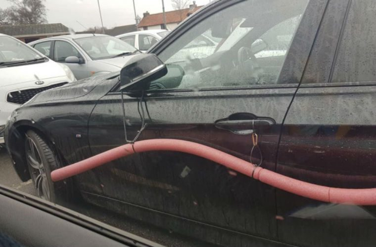 BMW owner avoids car park dents with crude foam protection