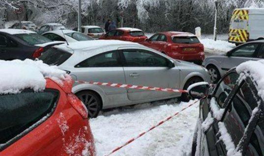 Parking warden slaps parking tickets on cars left stranded in snow