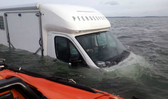 Driver has a mare as horsebox is left stranded on causeway at high tide