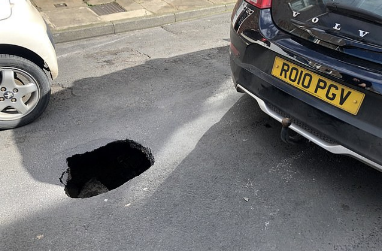 Driver shock as Volvo C30 became trapped in four-foot-deep pothole