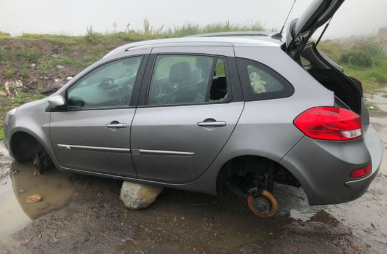 Clio owner returns to car and finds it stripped of parts and left balancing on rocks