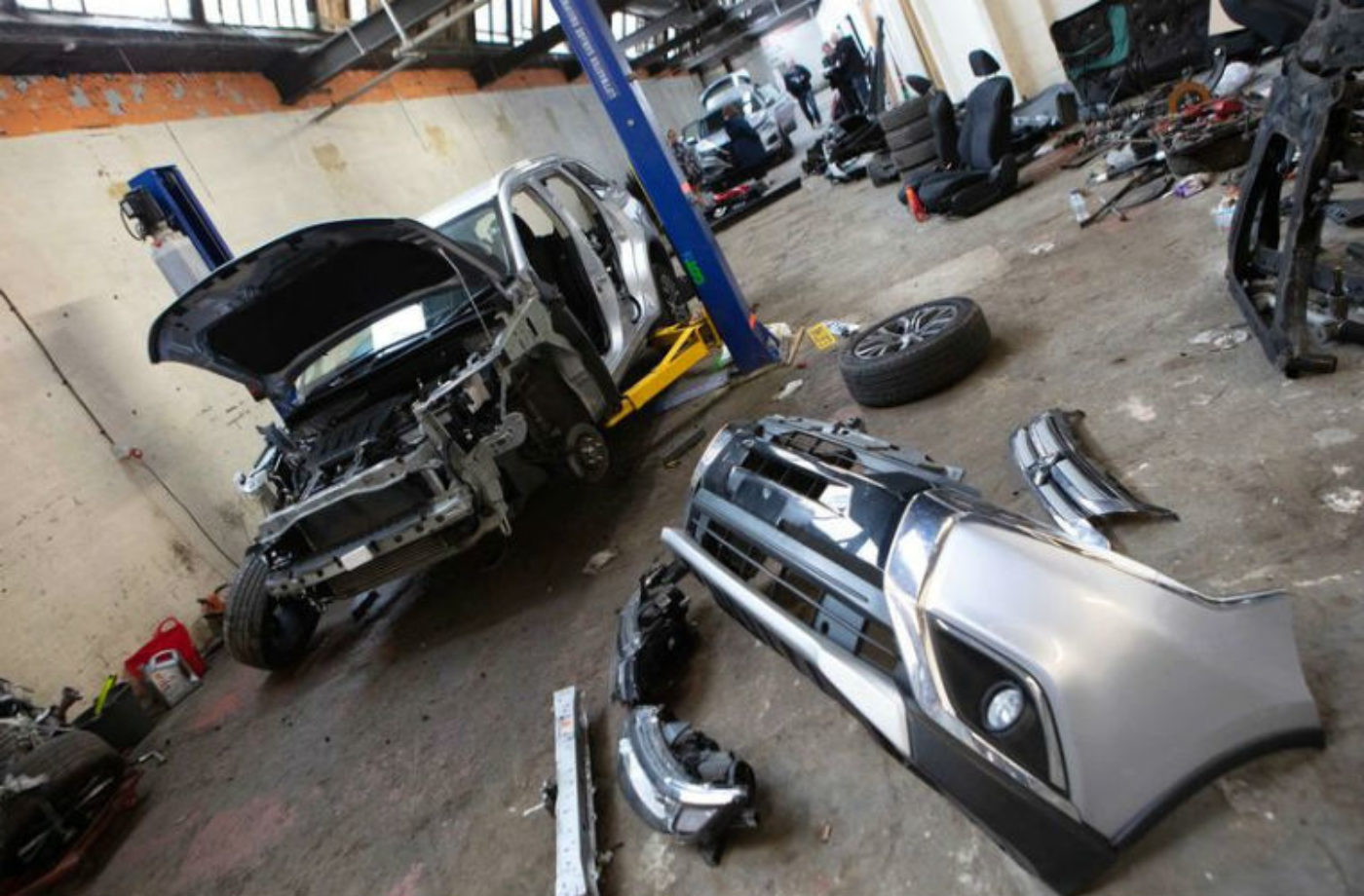 Car parts, cash and suspected stolen cars seized from Manchester workshops