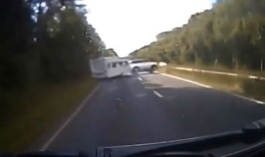 Watch: Caravan flips on dual carriageway sending dog flying