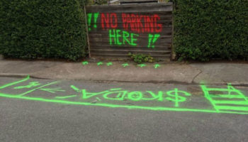 Skoda driver spray paints DIY road markings outside home to reserve space