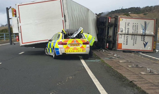 Watch: Lorry crushes police car in high winds