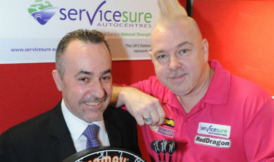 Servicesure celebrates the New Year in style thanks to darts champ partnership