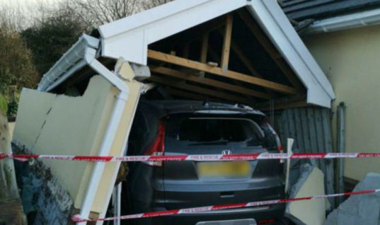 Pair trapped in car as home garage collapses on top of it