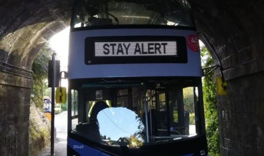 Bus driver ignores 'stay alert' public health message and gets stuck under bridge