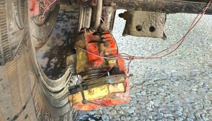 Police stop car with bodged brake caliper dangling off