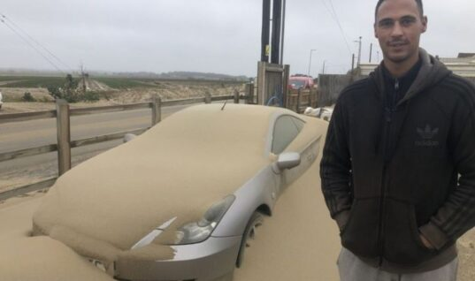Video: Cars left buried following sand storm on Norfolk coast